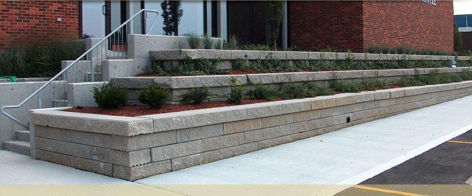 school landscaping in retaining wall